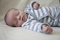 Portrait of sleeping baby boy lying on blanket - RBF001607