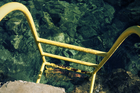 Croatia, Korcula, Prizba, Yellow ladder at the sea - KAF000083