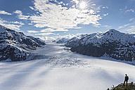 Border region Alaska-British Columbia, Man looking at Salmon Glacier - FOF005456