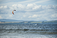UK, Scotland, Burghead Bay, Kitesurfer in the ocean - PA000143