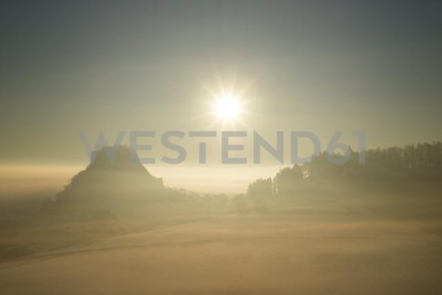 Germany, Baden-Wuerttemberg, Konstanz district, Hegau with Hohenkraehen at sunrise - ELF000759
