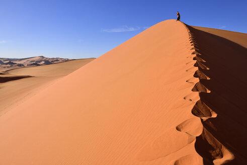 Algeria, Sahara, Tassili N'Ajjer National Park, Tadrart, woman hiking a dune of Tin Merzouga - ES000868
