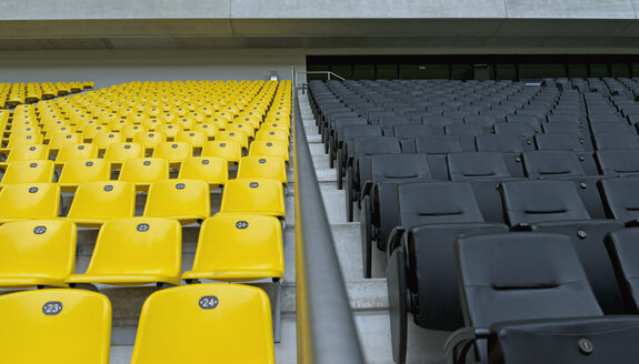 Germany, North Rhine-Westphalia, Aachen, football stadium Tivoli, yellow and black seats, tribune - HL000329