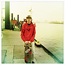 boy with a longboard staying on a landing jetty, harbour, Hamburg, Germany - SE000208