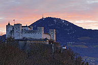 Austria, Salzburg State, Salzburg, View from Moenchsberg to Hohensalzburg Castle at sunset - GF000357