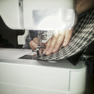 Hands of a woman at sewing machine - HAF000239
