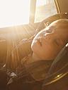 Sleeping girl in the car, Munich, Bavaria - GSF000595