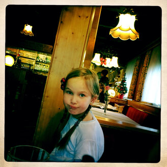 Girl in a restaurant in Rust, Baden-Wuerttemberg, Germany. - DHL000245