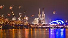 Germany, North Rhine-Westphalia, Cologne, skyline at New Year's Eve with fireworks - WGF000194