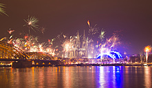 Germany, North Rhine-Westphalia, Cologne, skyline at New Year's Eve with fireworks - WGF000192