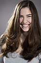 Portrait of laughing young woman, studio shot - MAEF007620