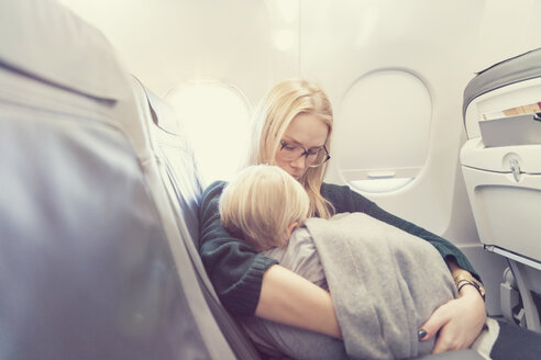 Mother with son in airplane - MF000729