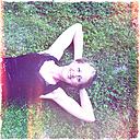 In the garden, woman lying on meadow enjoying summer, North Rhine-Westphalia, Germany - ONF000377