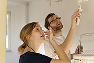 Young couple renovating new apartment - LAF000430
