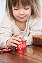 Little girl playing with dolls china set - LVF000446