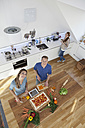 Three friends cooking together, top view - RBF001528