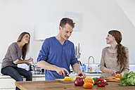 Three friends cooking together - RBF001596