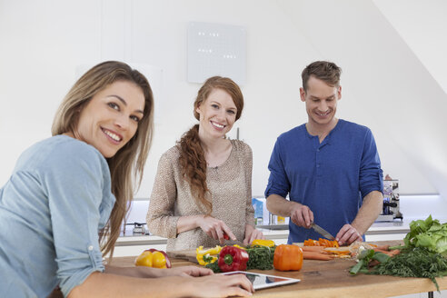 Three friends cooking together - RBF001525
