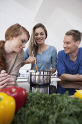 Three friends cooking together - RBF001523