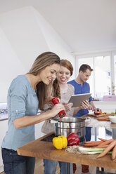 Three friends cooking together - RBF001507