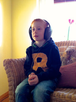 Boy with headphones, Germany, Baden-Wuerttemberg, Constance - JEDF000047