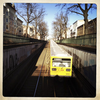 Underground train coming overground at Nice Allee, Berlin, Germany - ZM000076