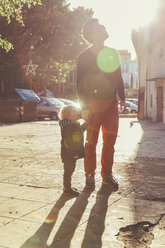 Italy, Sicily, Palermo, Father and son talking a walk - MFF000759