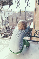 Italy, Sicily, Palermo, Blond boy on balcony - MFF000745