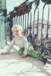 Italy, Sicily, Palermo, Blond boy on balcony - MFF000746