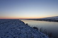 Germany, Lower Saxony, snow covered winter landscape by sunset - SJF000082