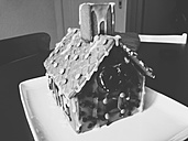 Gingerbread house standing on table at home - MEAF000027