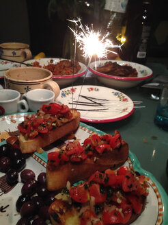 New Years eve food with sparkler, Palermo, Sicily, Italy - MEAF000082