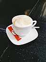 Cup of cappuccino on a black table of marple in Lisbon, Portugal, Latvia - SE000408