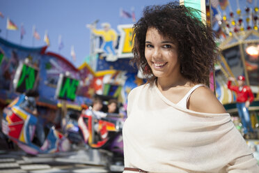 Germany, Herne, Young woman at fairground, portrait - BGF000077