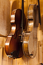 Violins in a violin maker's workshop - TCF003799