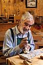 Violin maker at work - TCF003795