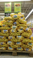 Potato bags in the grocery store, Bavaria, Germany - MAE007596