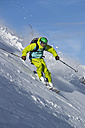 Austria, Tyrol, Kitzbuehel, Man off-piste skiing - FF001392