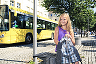 Girl with backpack sitting at bus station - VTF000056