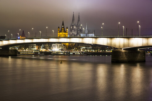 Germany, North Rhine-Westphalia, Cologne, view to Deutz Bridge, Great St Martin and Cologne Cathedral by night - JATF000570