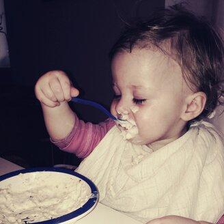 Small child eats porridge - GSF000683