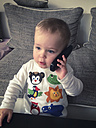 Toddler child playing with real phone, Goettingen, Germany - ABA001161
