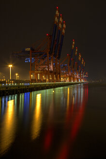 Germany, Hamburg, Container harbour Burchardkai at night - TI000003