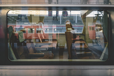Japan, Reflections on a train window of a local train - FL000352
