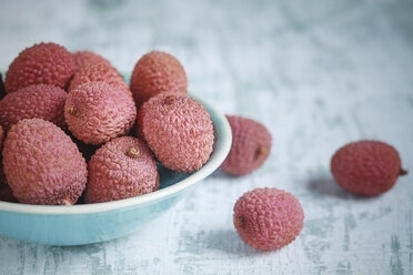 Bowl of lychees on white wooden table - SBDF000437