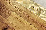 Laying finished oak parquet flooring, close-up - BIF000299