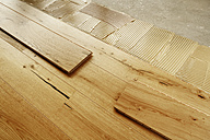 Laying finished oak parquet flooring, close-up - BIF000297