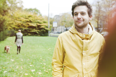 Portrait of smiling young man on grass verge - FEXF000071