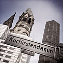 Street sign Kurfuerstendamm (Kurfuerstendamm) with Memorial Church, Berlin, Germany - ZM000125