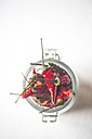 Preserving jar of dried red chili pods, elevated view - SARF000200
